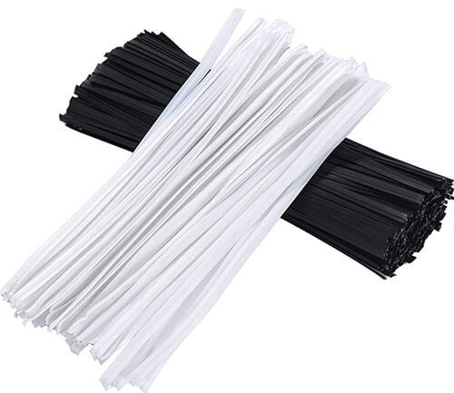 white and black plastic coated twist ties